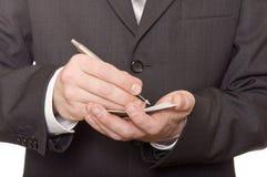De hand van de zakenman het schrijven Stock Foto