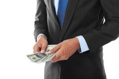 De hand van de zakenman met geld stock foto