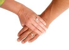 De hand van een man en een vrouw Stock Foto's