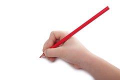 De hand van het kind trekt een rood potlood. Horizontaal. royalty-vrije stock afbeeldingen
