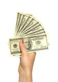 De hand van het meisje met dollars Stock Foto