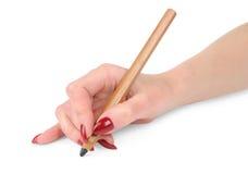 De hand van het meisje met het potlood Stock Fotografie
