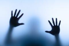 De hand van het onduidelijke beeld Stock Foto