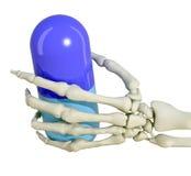 De hand van het skelet met pil Stock Foto's