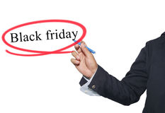 De hand van jonge zakenman schrijft het woord Black Friday geïsoleerd o stock fotografie