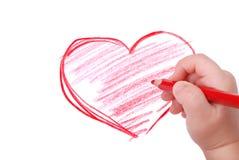 De hand van kinderen met potlood trekt het hart Royalty-vrije Stock Foto's
