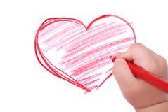 De hand van kinderen met potlood trekt het hart Stock Afbeelding
