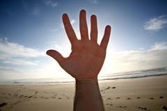 De hand van Opem Stock Foto's