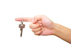 De hand van Womans met sleutel Royalty-vrije Stock Afbeelding