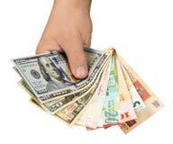 In de hand verschillende munten van landen Stock Foto