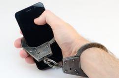 De handen cuffed telefoon Royalty-vrije Stock Afbeelding