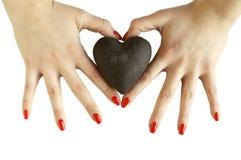 De handen die van de vrouw hart houden Stock Foto