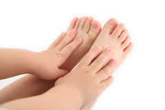 De handen en de voet van het kind Stock Foto's