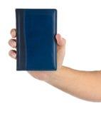 De handen houden een notitieboekje op wit Royalty-vrije Stock Afbeeldingen