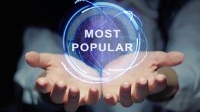 De handen tonen om populairste hologram stock footage