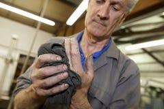 De handen van arbeiders Stock Foto's