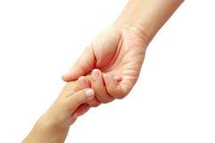 De handen van de baby en van de moeder Stock Foto