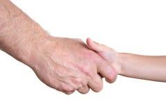 De handen van de grootvader en van de jongen stock foto