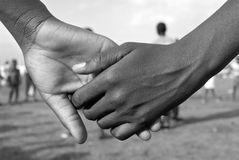 De Handen van de holding Stock Afbeeldingen