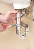 De handen van de loodgieter Royalty-vrije Stock Afbeeldingen