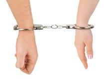 De handen van de man en van de vrouw en brekende handcuffs stock fotografie