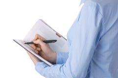 De handen van de onderneemster schrijven in blocnote. Royalty-vrije Stock Afbeeldingen
