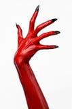 De handen van de rode Duivel met zwarte spijkers, rode handen van Satan, Halloween-thema, op een witte geïsoleerde achtergrond, Stock Foto
