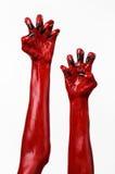 De handen van de rode Duivel met zwarte spijkers, rode handen van Satan, Halloween-thema, op een witte geïsoleerde achtergrond, royalty-vrije stock foto's