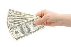 De handen van de vrouw met geld Stock Afbeeldingen