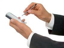 De handen van de zakenman met palmtop royalty-vrije stock afbeeldingen