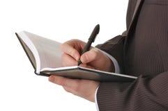 De handen van de zakenman schrijven in blocnote Royalty-vrije Stock Fotografie