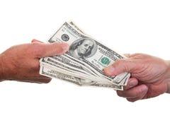 De Handen van het geldwisselen stock foto's
