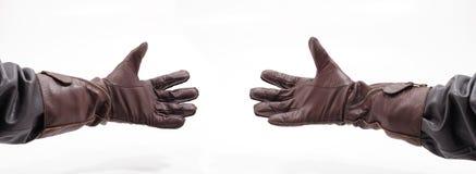 De handen van mensen met leerhandschoenen Royalty-vrije Stock Afbeelding