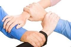De Handen van teams Stock Afbeelding
