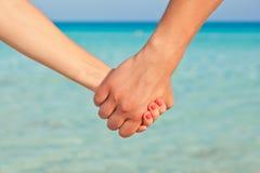 De handen van twee mensen Stock Foto