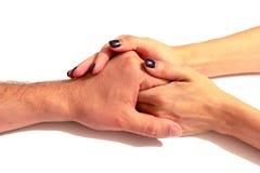 De handen van de vrouw houden zacht de hand van haar echtgenoot isola royalty-vrije stock afbeelding