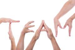 De handen vormen het woordteam Stock Fotografie