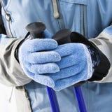 De handschoenen en de polen van de ski. Stock Foto's