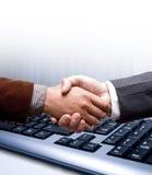 De handschok van de elektronische handel stock afbeelding