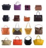 De handtassen van het vrouwenleer op witte achtergrond worden geïsoleerd die Royalty-vrije Stock Afbeelding