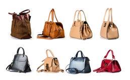 De handtassen van het vrouwenleer op witte achtergrond worden geïsoleerd die Stock Fotografie
