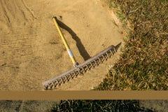 De hark van het zand Stock Afbeeldingen
