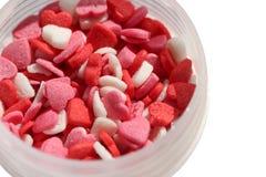 De hart-vormige suiker bestrooit geïsoleerd op witte achtergrond Stock Foto