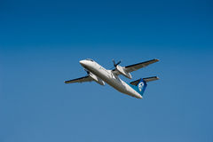 De Havilland Dash-8 taking off Stock Photography