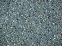De havssanden och kiselstenarna Royaltyfria Bilder