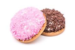 De heemstkoekjes met Roze en Chocolade bestrooit Stock Afbeelding