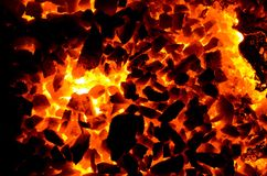 De heldere achtergrond bestaat uit textuur van hete steenkool stock foto