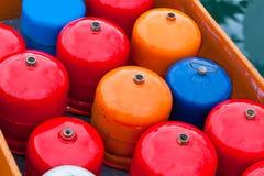 De heldere flessen van het metaalgas Stock Afbeeldingen