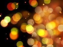 De heldere oranje gloed met gouden vage ronde steekt fonkelende nacht abstracte achtergrond aan stock fotografie