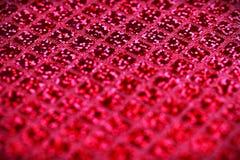 De heldere roze fuchsia schittert de stoffenachtergrond van het vierkantenlovertje Royalty-vrije Stock Foto